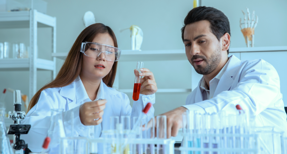 male and female conducting experiments in lab